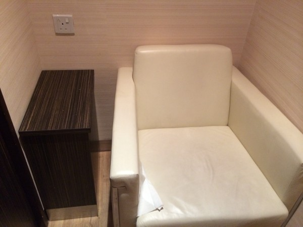 Power Socket, Small Table and Single Sofa in the Cubicle