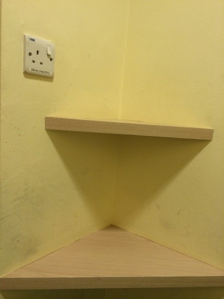 Small Shelf and Power Socket in the Cubicle
